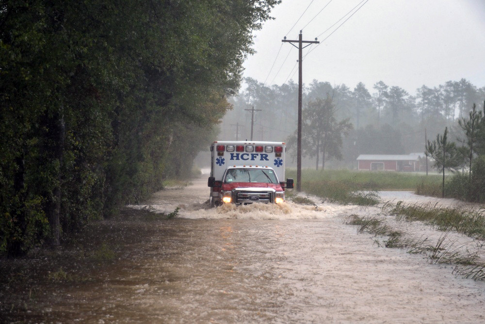 Soldiers with the 1-178th Field Artillery Battalion, South Carolina Army National Guard (ACNG) help escort Horry County Fire Rescue paramedics through flooded roads to reach someone in need of medical attention in Conway, S.C., during Hurricane Matthew, Friday, Oct. 8, 2016 | U.S. Air National Guard photo by Tech. Sgt. Jorge Intriago