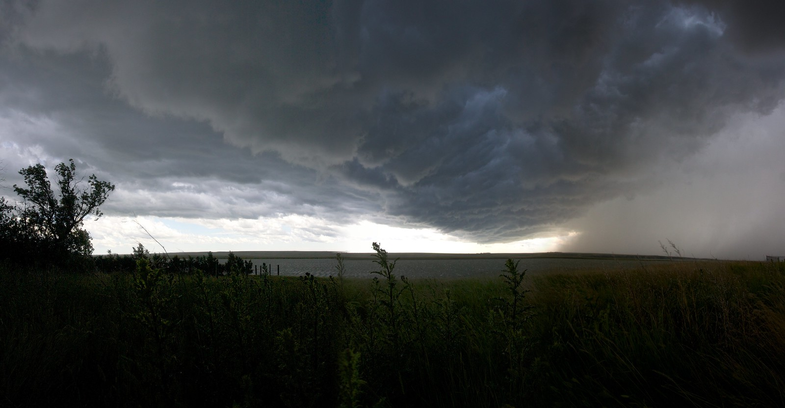 Approaching Thunder- Unlike many other parts of our Nation, where skyscape views are obstructed by trees, mountains, and higher-density land uses, in the the Northern Prairie one can see whole storm fronts advancing | Medicine Lake NWR Storm
