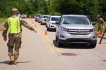 U.S. Army 1st Lt. Nicholas Barnett, 48th Infantry Brigade Combat Team, Georgia National Guard, directs traffic at a COVID-19 mobile testing site in Albany, Georgia, May 19, 2020. Senior Master Sgt. Roger Parsons