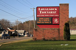 An electronic sign announces school closure due to COVID-19 in Williamsport, PA, USA. Brinacor