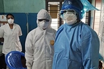 Healthcare workers wearing personal protective equipment while caring for patients with coronavirus infection in the Indian state of Kerala. Javed Anees