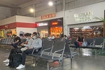People wearing masks at Monterrey Airport due to the COVID-19 pandemic. Davidmejoradas