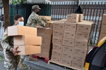Sgt. Thalia Santos from Yonkers, N.Y., a member of the New York Army National Guard, carries boxed meals to a waiting vehicle at a food distribution site in The Bronx, N.Y., August 5, 2020. Senior Airman Sean Madden