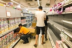 Ntuc super store, Singapore - Singaporean clear out the supermarket shelves due to the Coronavirus. cattan2011